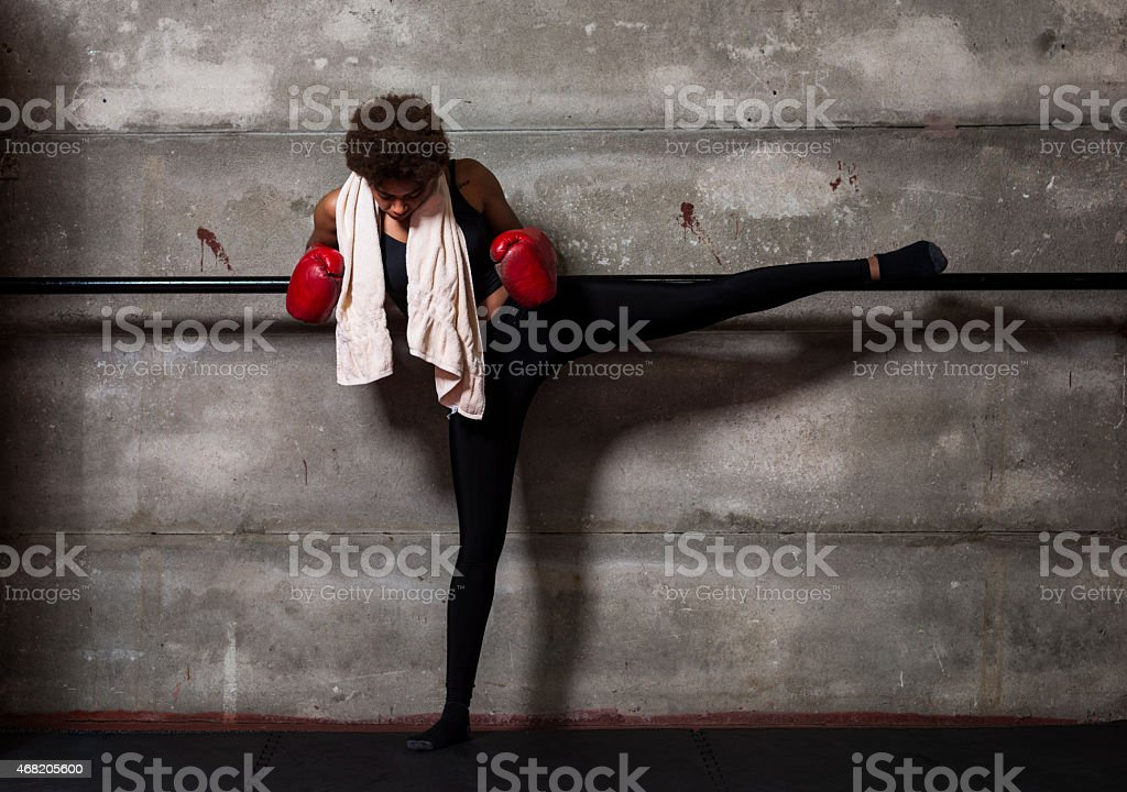 Young african woman training at gym stock photo