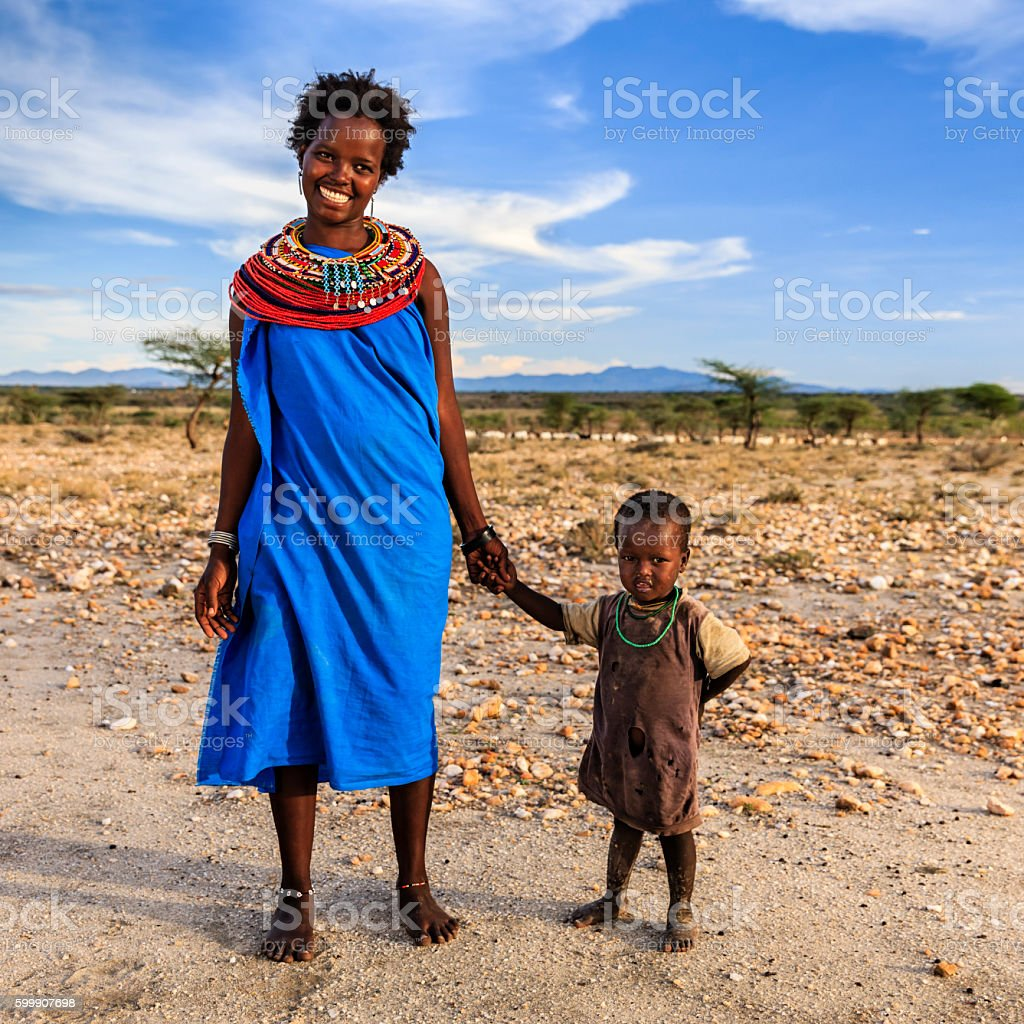 Young African woman walking with her baby, Kenya, East Africa stock photo