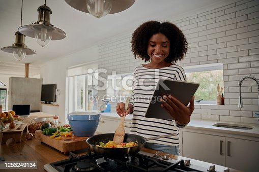 Woman watching recipe in digital tablet
