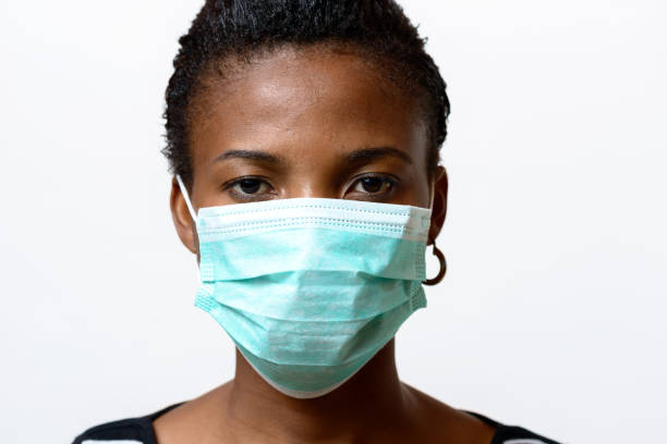 Young African woman wearing a face mask stock photo