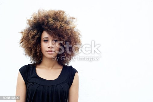 istock Young african woman with curly hair 506816590