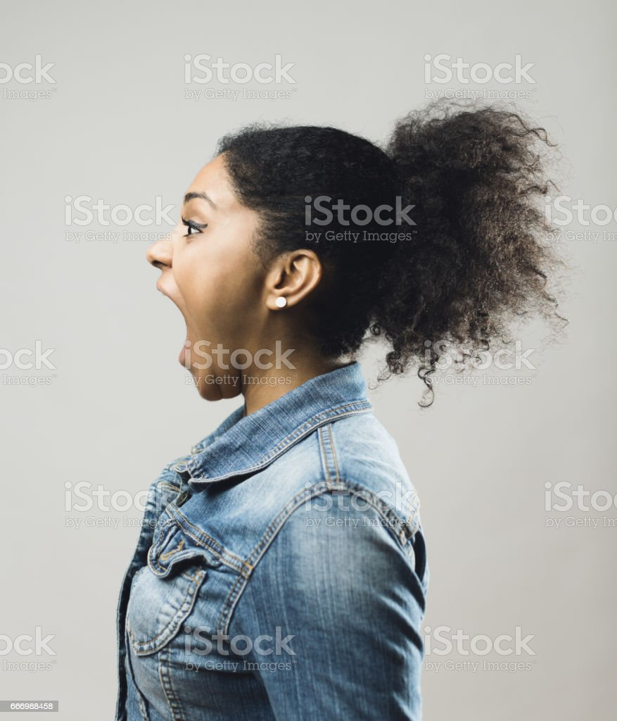 Young african woman with her mouth open stock photo