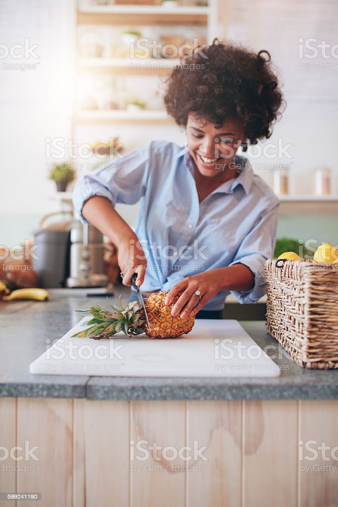Young african woman working at juice bar stock photo