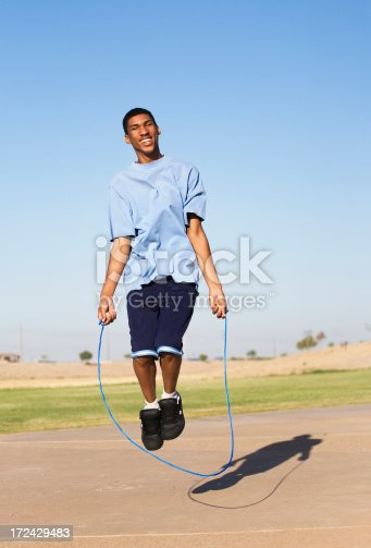istock Young African-American adult jump roping outdoors 172429483