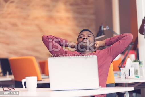 istock Young African-American business man taking a break at his desk 638599324