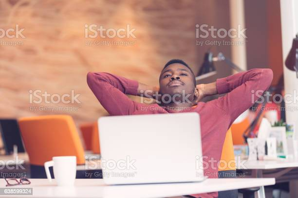 Young africanamerican business man taking a break at his desk picture id638599324?b=1&k=6&m=638599324&s=612x612&h=ucb0oa67vpkjanwdvhxv3ccerfub2 rpjfzhqeqk9pw=