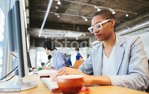 istock Young African-American businesswoman working in modern working place 1061331784