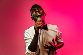 istock Young african-american jazz musician singing a song 1158169305