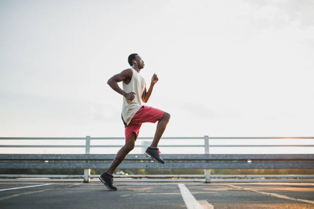 Young African-American male jogging stock photo
