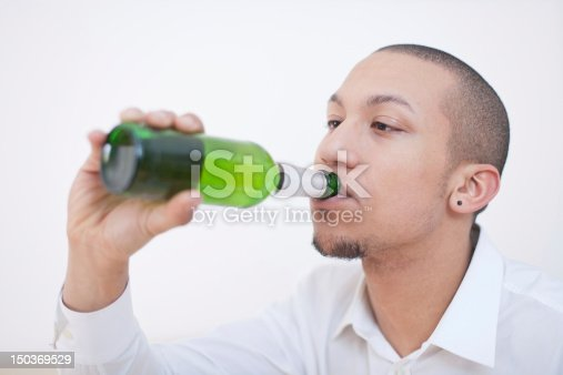 istock Young African-American Man Drinking Beer 150369529
