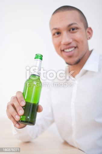 istock Young African-American Man Drinking Beer 150375271