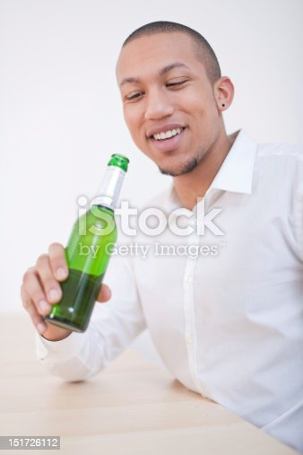 istock Young African-American Man Drinking Beer 151726112