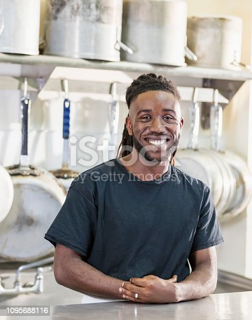 istock Young African-American man working in commercial kitchen 1095688116