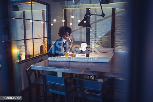 918035432 istock photo Young African-American woman architect working on a project. 1036803292