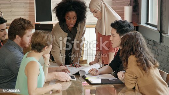 istock Young African-American Woman Leads Multi-Ethnic Team Meeting 640898958