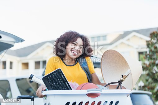 istock Young African-American woman moving house 899704712