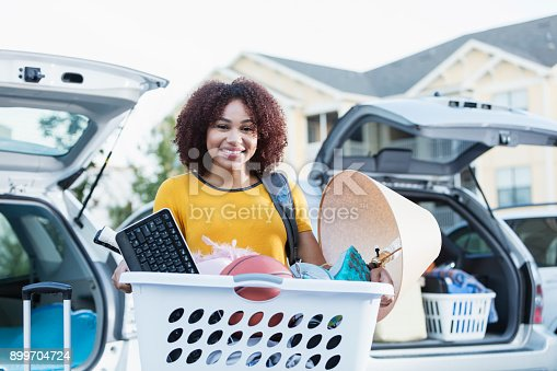 istock Young African-American woman moving house 899704724