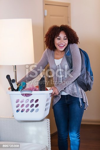 istock Young African-American woman moving in 899705358