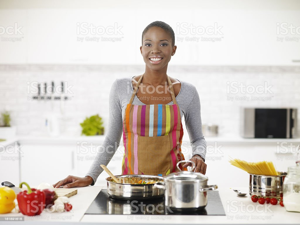 Young African-American Woman Preparing Delicious Lunch stock photo