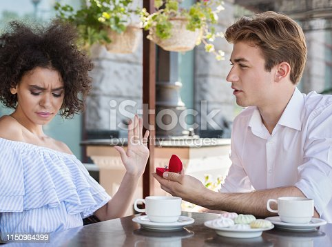 1129577106 istock photo Young african-american woman said no to proposal 1150964399