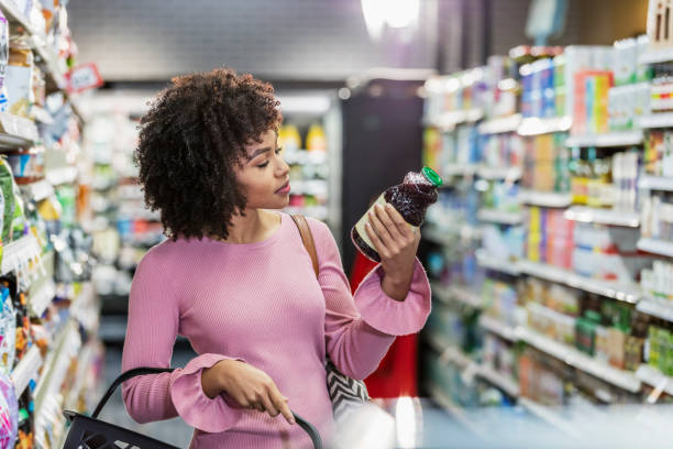 Young African-American woman shopping in supermarket stock photo