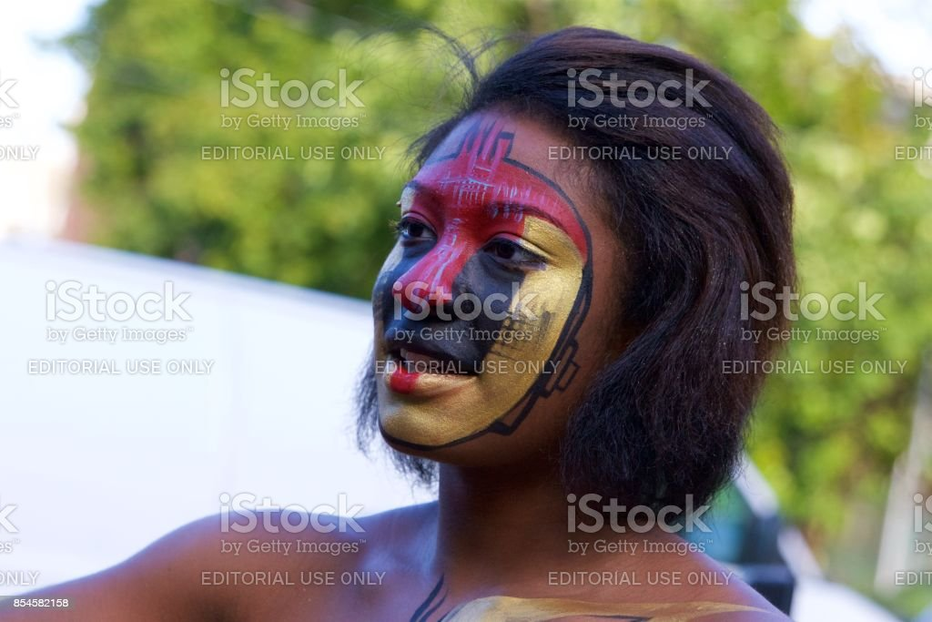 young African-American woman with her face painted stock photo