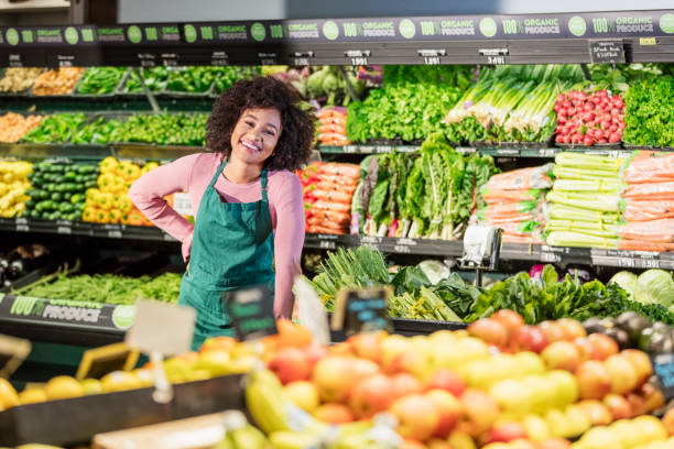 Young African-American woman working in grocery store stock photo