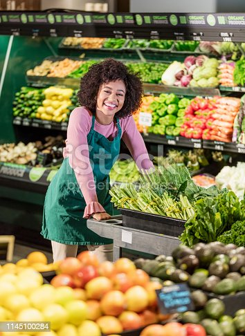 istock Young African-American woman working in grocery store 1145100284