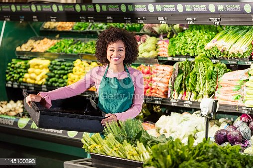 istock Young African-American woman working in grocery store 1145100393