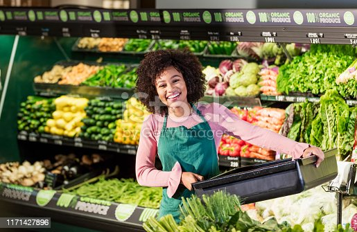 istock Young African-American woman working in grocery store 1171427896