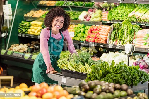 istock Young African-American woman working in grocery store 1171427897