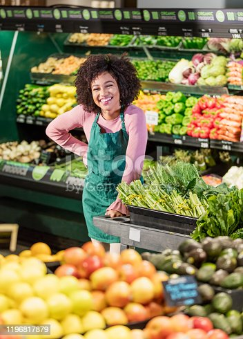 istock Young African-American woman working in grocery store 1196817879