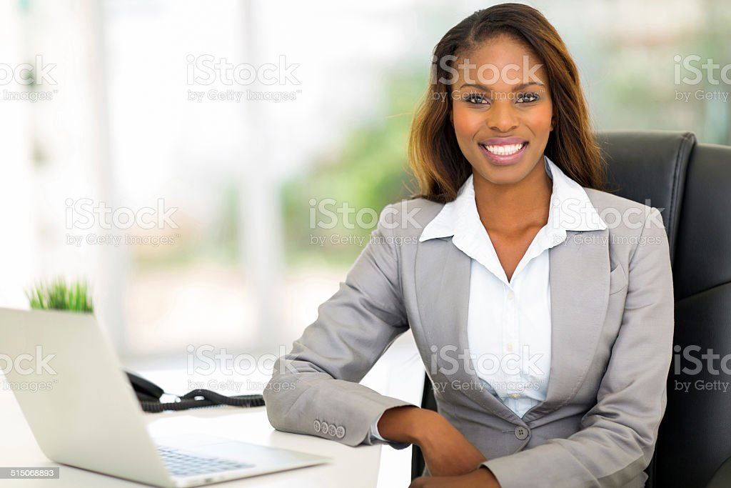 young afro american businesswoman sitting in office stock photo
