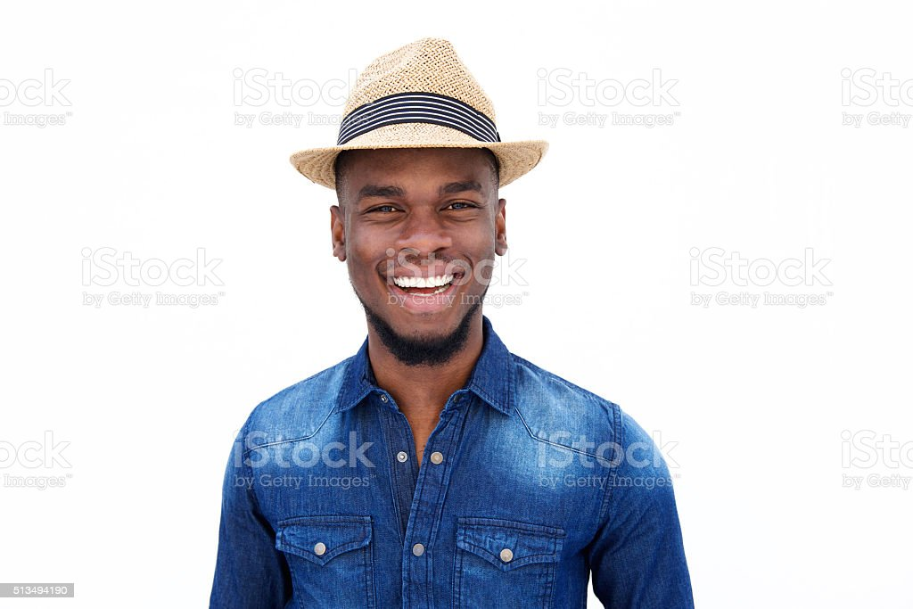 Young afro american man standing and laughing stock photo