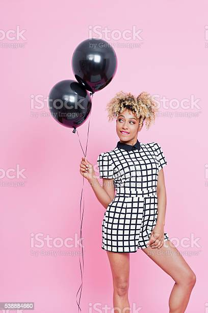 Young Afro American Woman Holding Two Black Balloons Stock Photo - Download Image Now