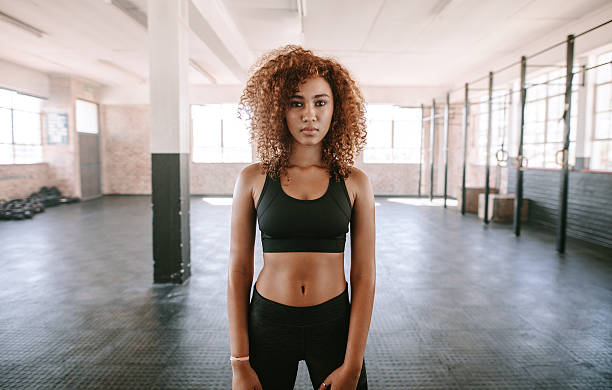 Young afro american woman in sportswear stock photo