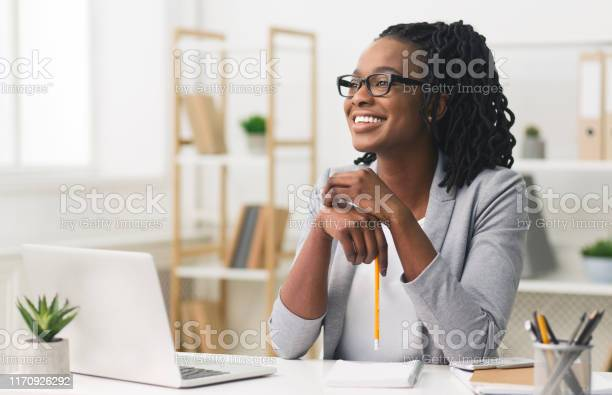 Young afro business lady smiling sitting in modern office picture id1170926292?b=1&k=6&m=1170926292&s=612x612&h=ng mzuwapwngxvrub9gl3lolk  jscs0heyvd cgxsg=