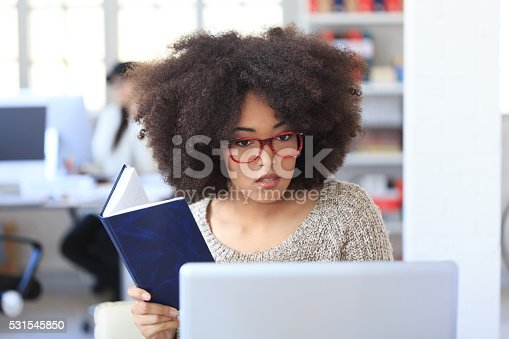 958531418 istock photo Young afro bussinesswoman having problems with laptop at workplace 531545850