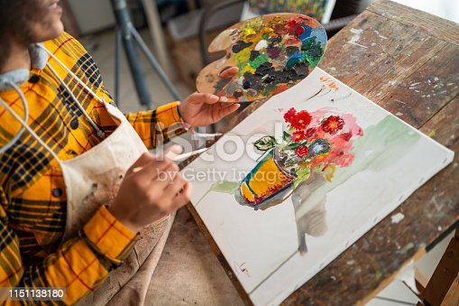 469937444 istock photo Young afro woman drawing 1151138180