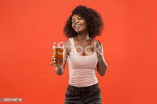 istock Young afro woman drinking beer, not isolated on white background 1002149716