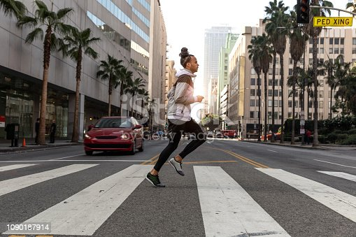 Young afroamerican man getting fit in Los Angeles downtown city streets, USA.