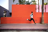 istock Young afroamerican man getting fit in Los Angeles downtown city streets 1164499120