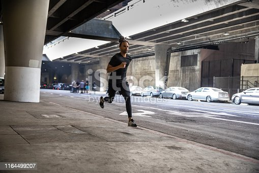 Young afroamerican man getting fit in Los Angeles downtown city streets