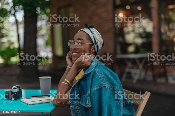 Young afroamerican woman is sitting on terrace picture id1167039207?b=1&k=6&m=1167039207&s=612x612&h=lztu69nvebxrqysujyvs3zesws1101bbcm 9vmst2z0=
