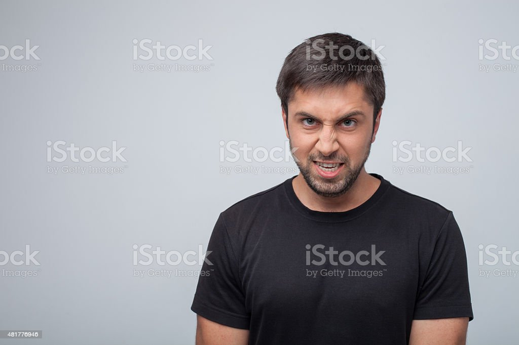 Young aggressive man is evincing his frustration stock photo