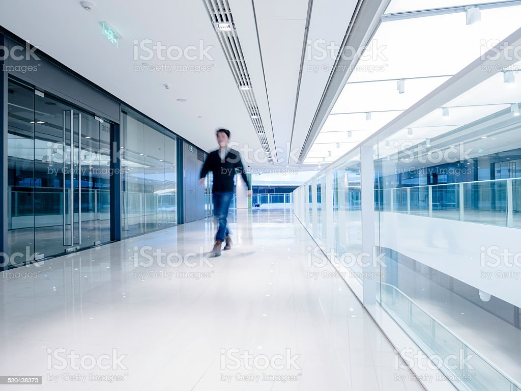 Young aisian businessman walking in architecture stock photo