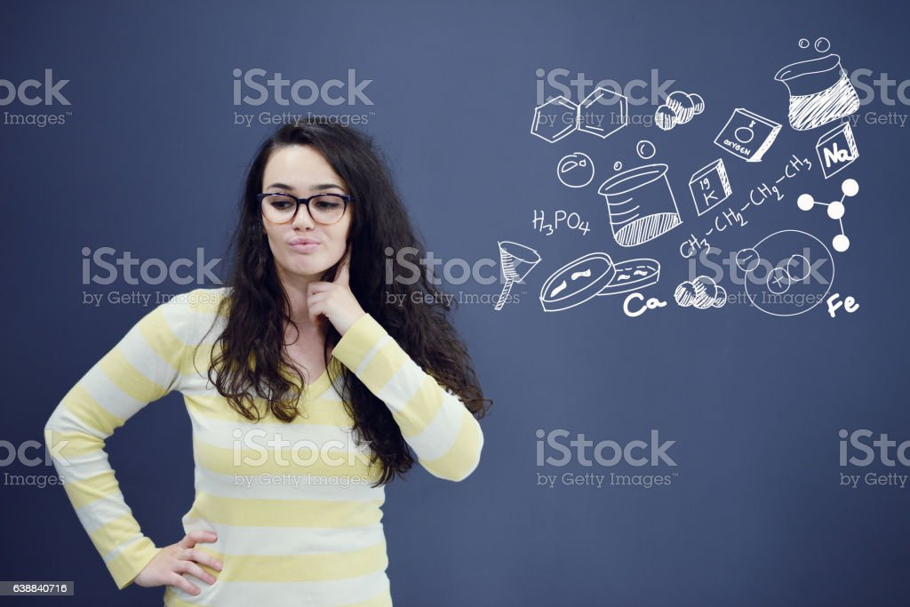 Young amazed woman on blue gray background with biology graphs. stock photo