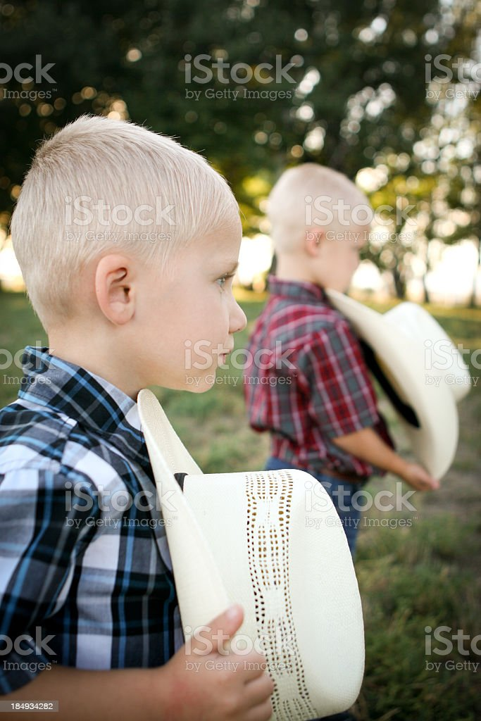 Young American cowboys showing respect royalty-free stock photo