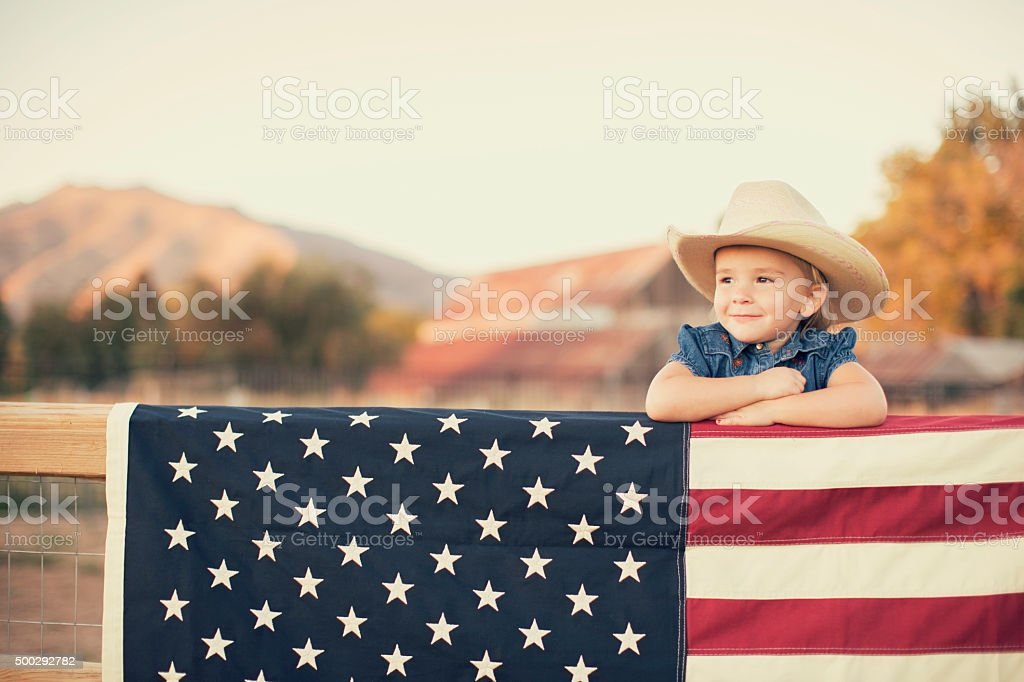 Young American Cowgirl with US Flag stock photo