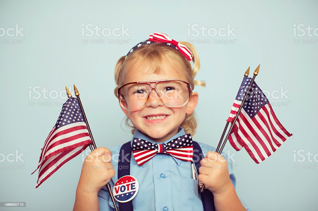 Young American Girl Holding Flags on Election Day stock photo